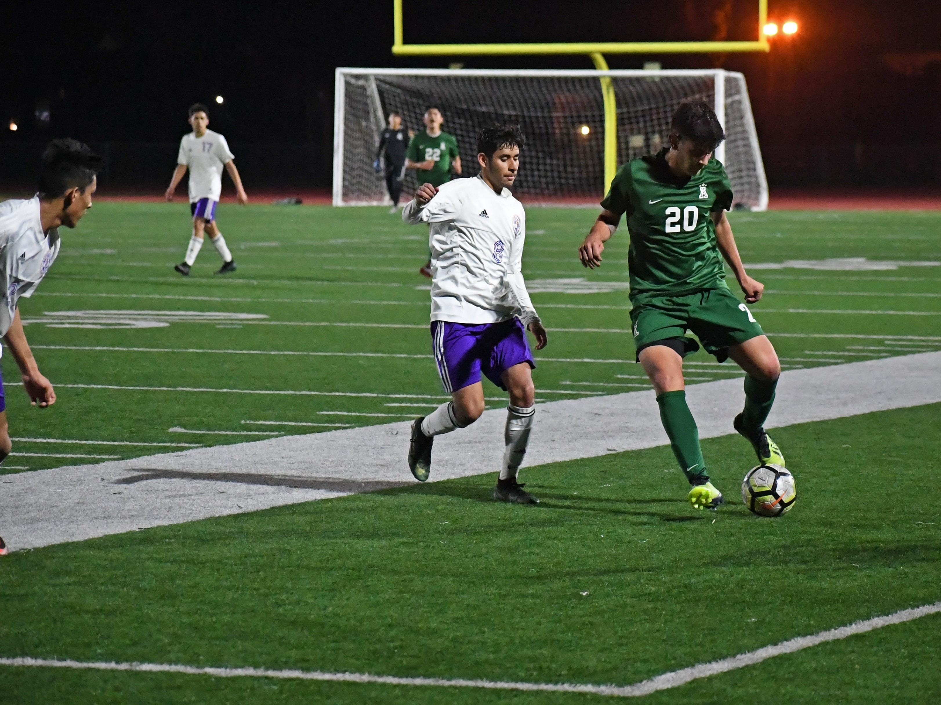 Alisal midfielder Abraham Montaño (20) keeps possession along the sideline.