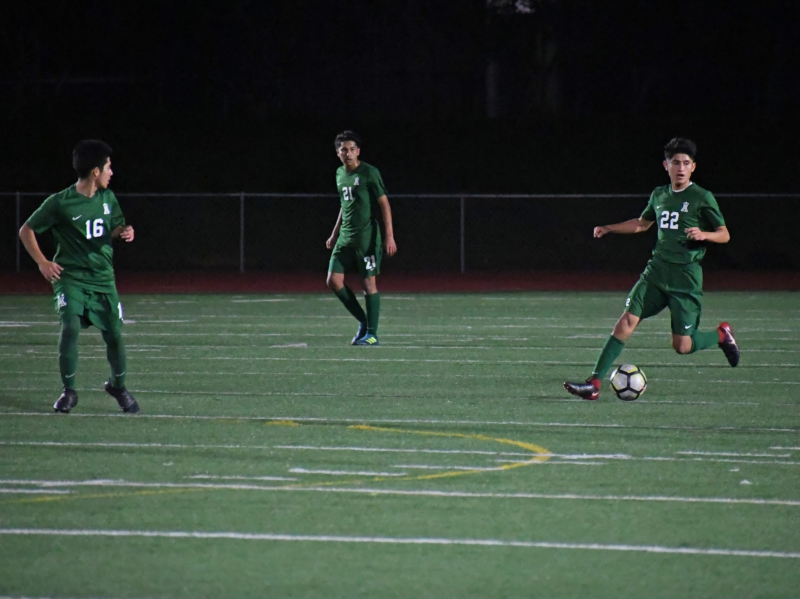 Alisal defender Joel Garcia (22) looks to pass the ball upfield.
