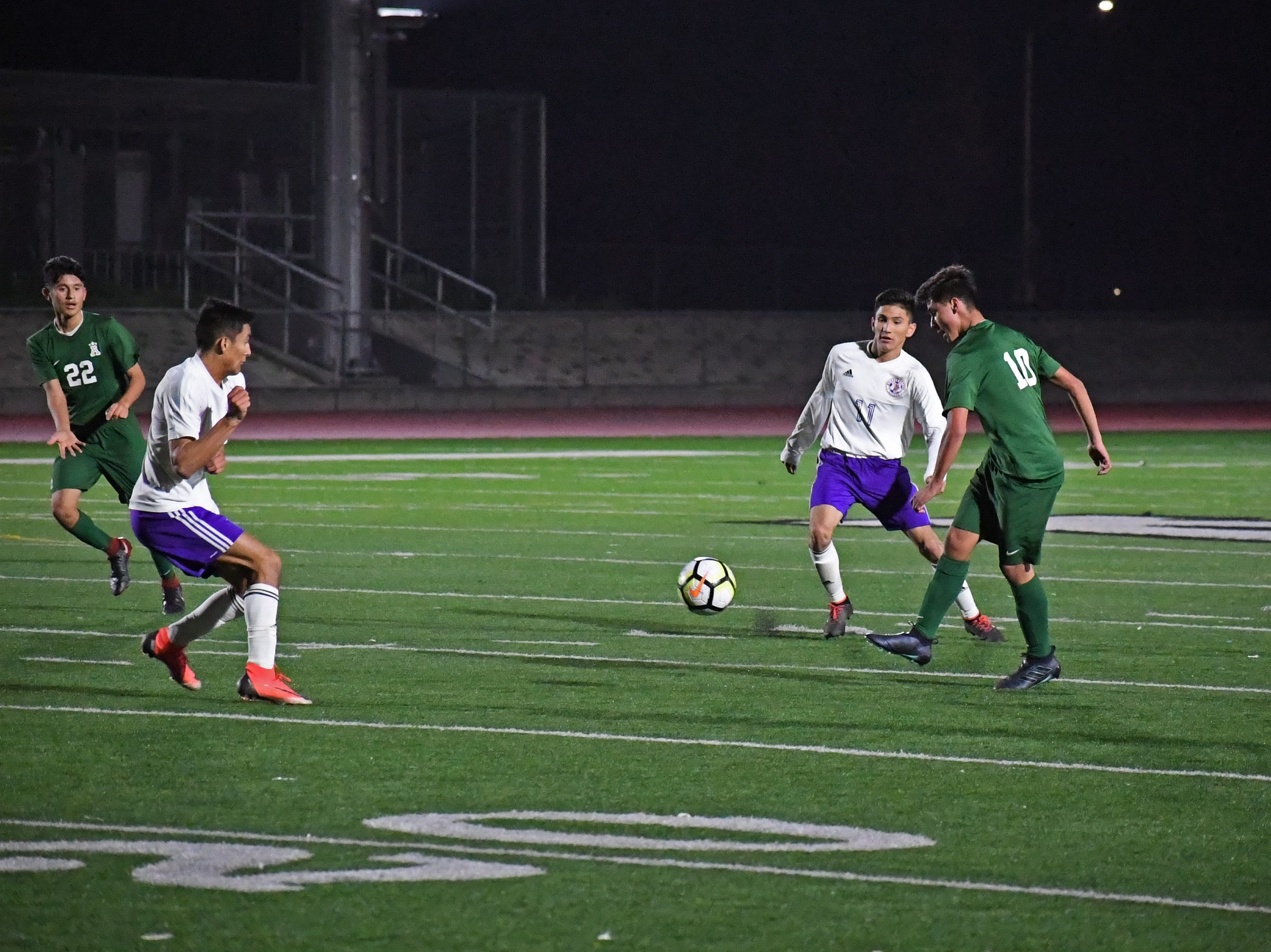 Alisal midfielder Jacob Cabrera (10) knocks a pass between two defenders.