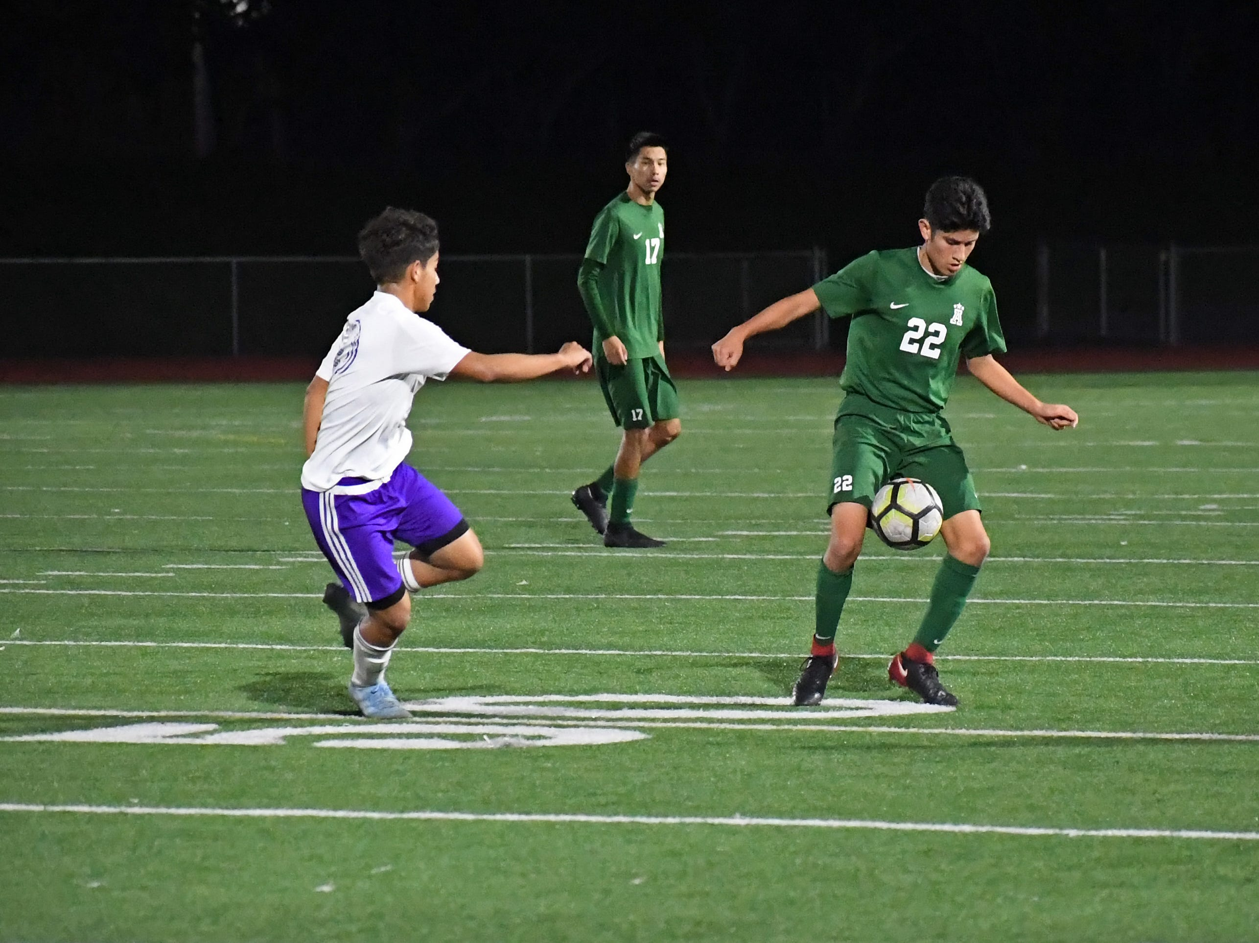 Alisal defender Joel Garcia (22) gathers the ball before passing upfield.