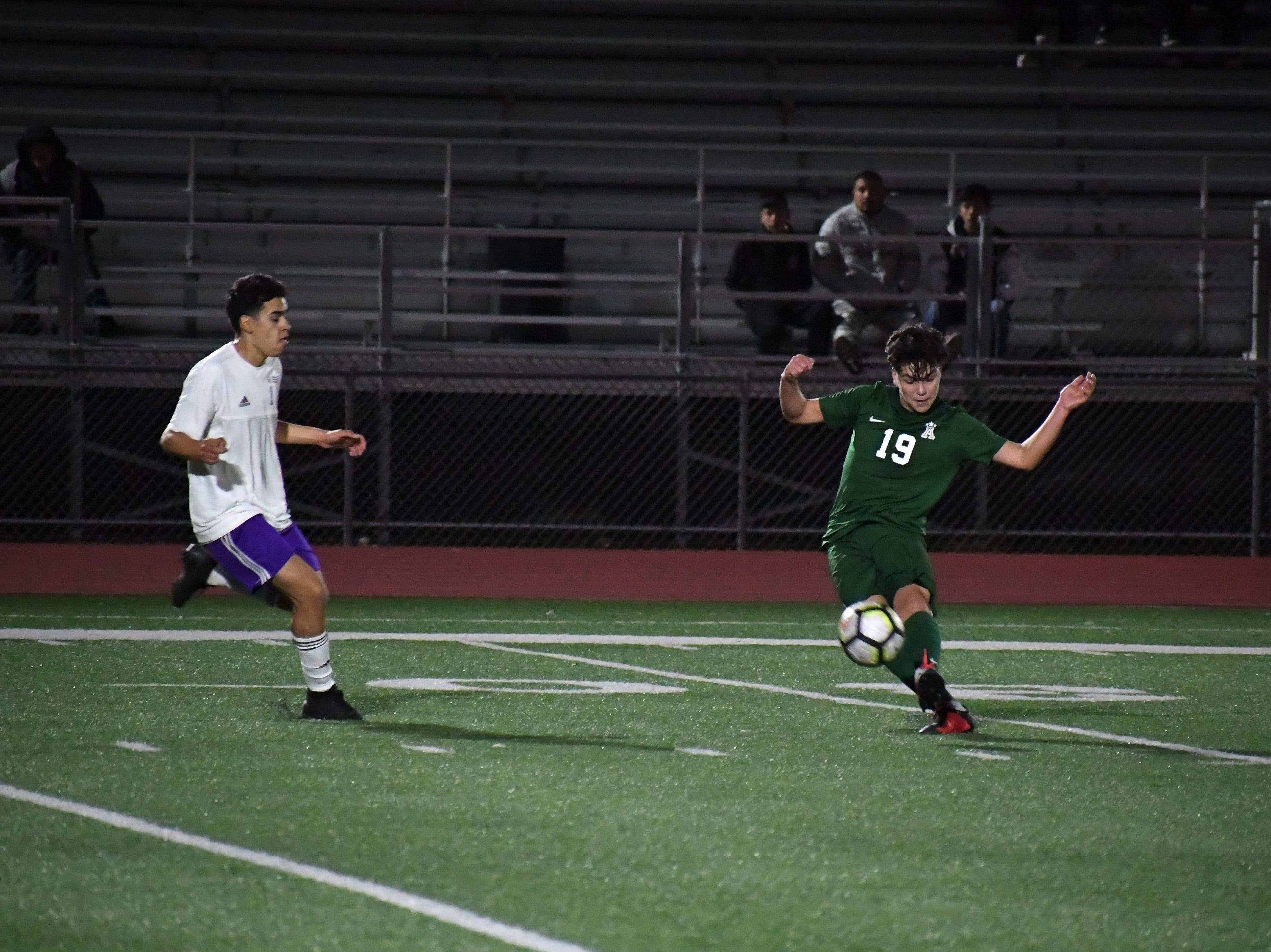 Alisal defender Jose Trujillo (19) fires a pass towards the box.