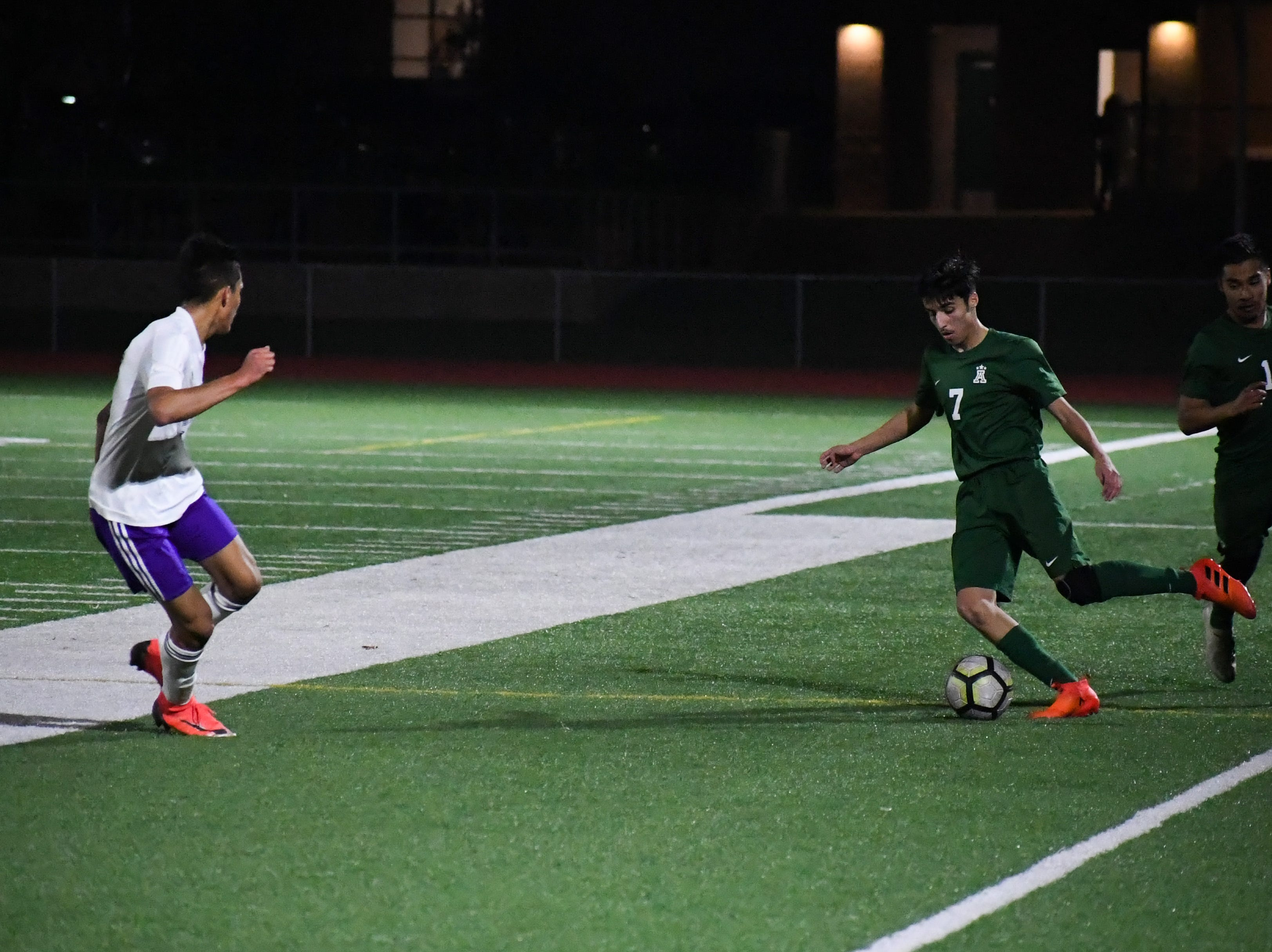 Alisal midfielder Julien Peguero (7) takes a throw-in upfield.