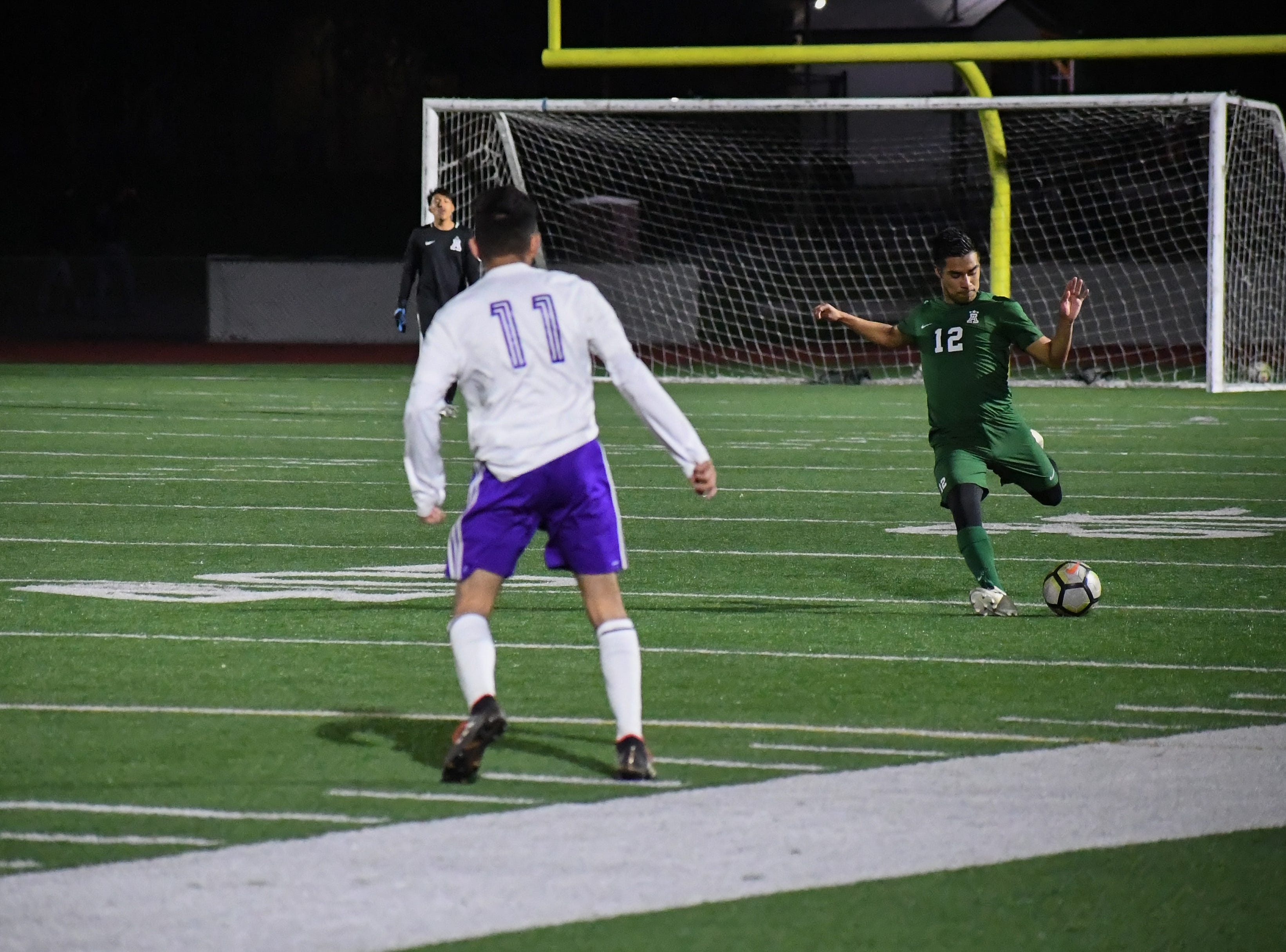 Alisal midfielder Jesus Gregorio (12) readies to fire a pass across midfield.