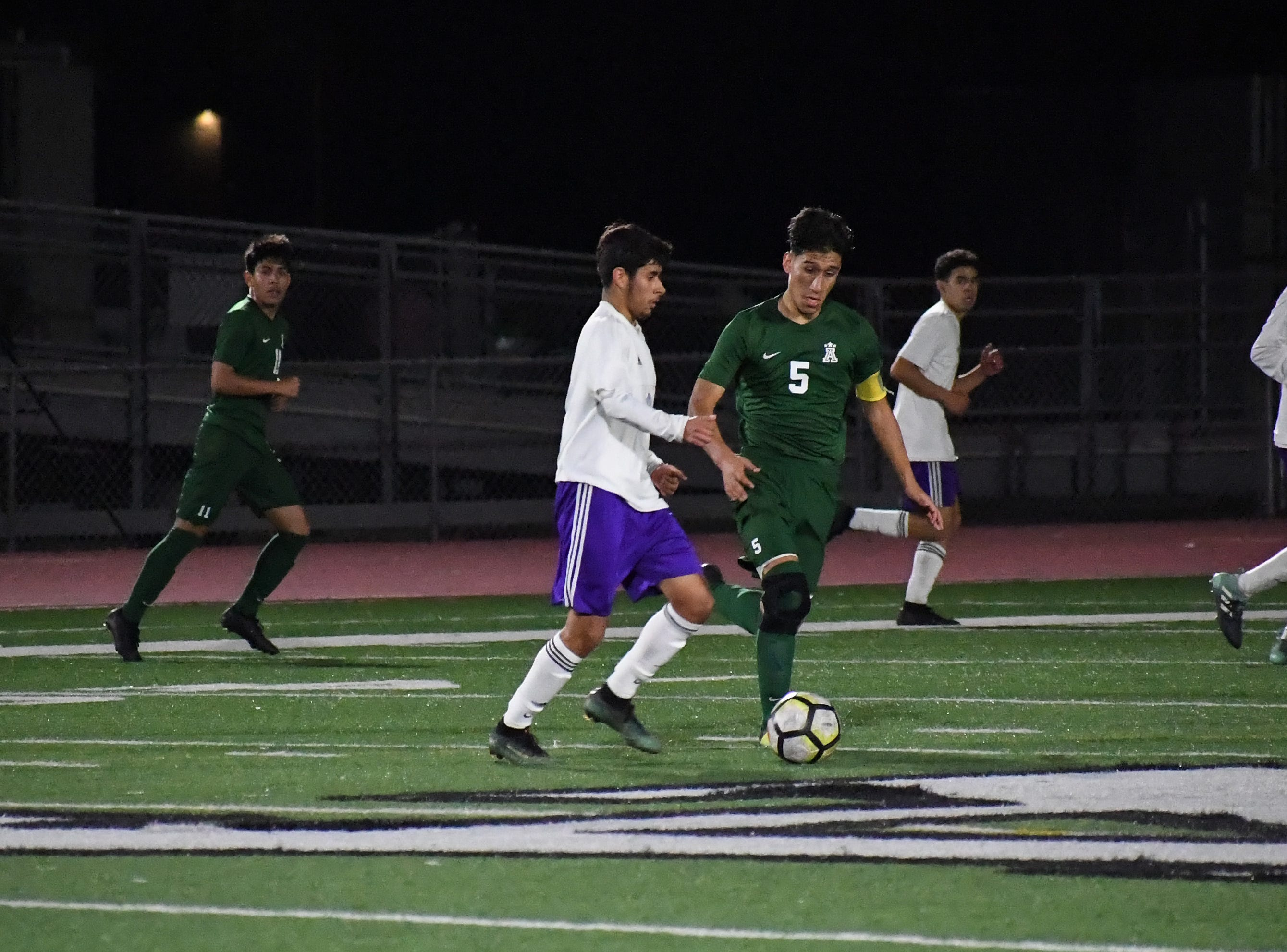 Alisal midfielder Osvaldo Avalos (5) fights for possession near midfield.
