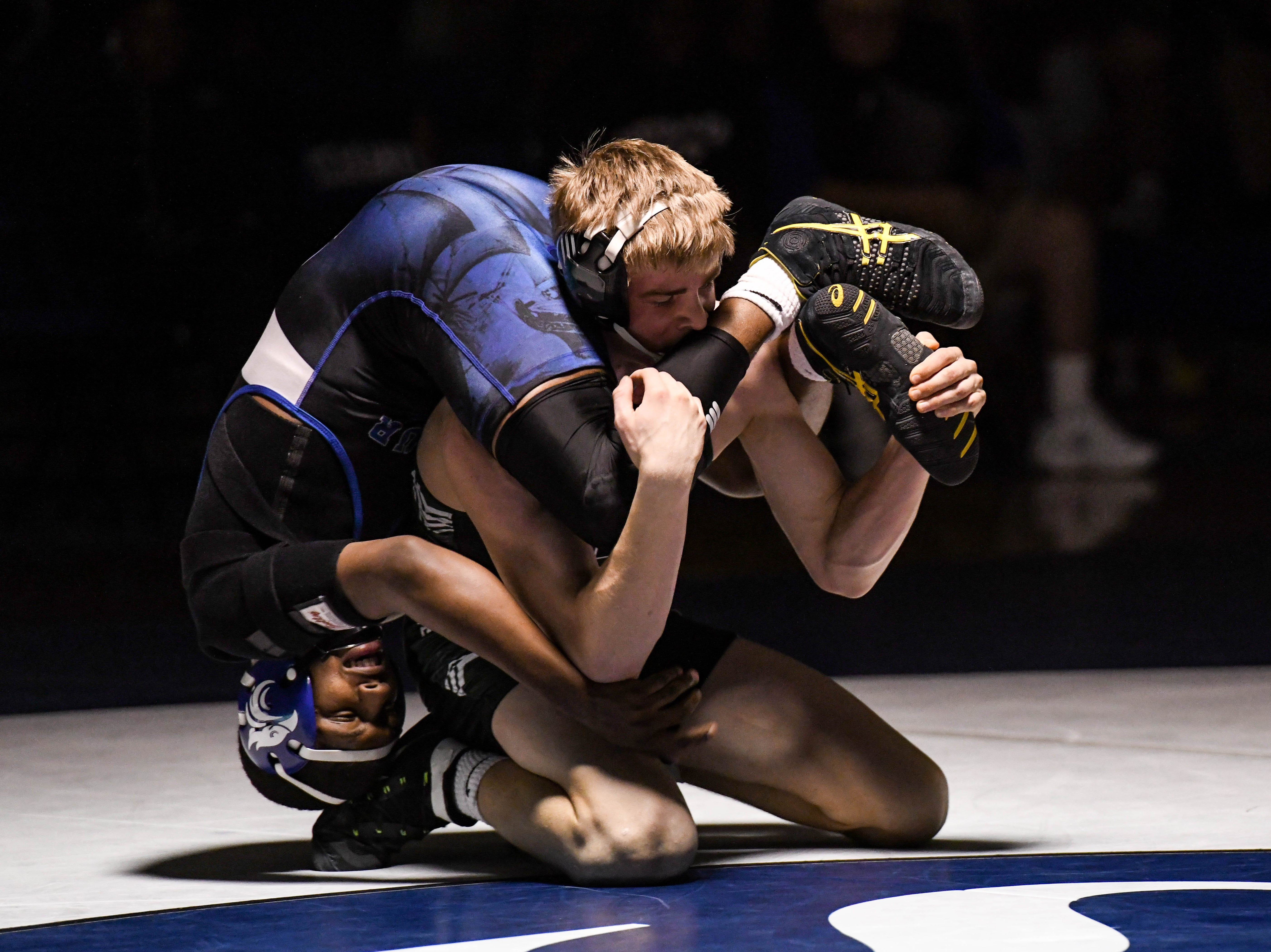 Stephen Decatur's Jhymir Blake wrestles against Parkside's Michael Daughtery in the 152 match up at Stephen Decatur High School on Wednesday, Jan. 23, 2019.