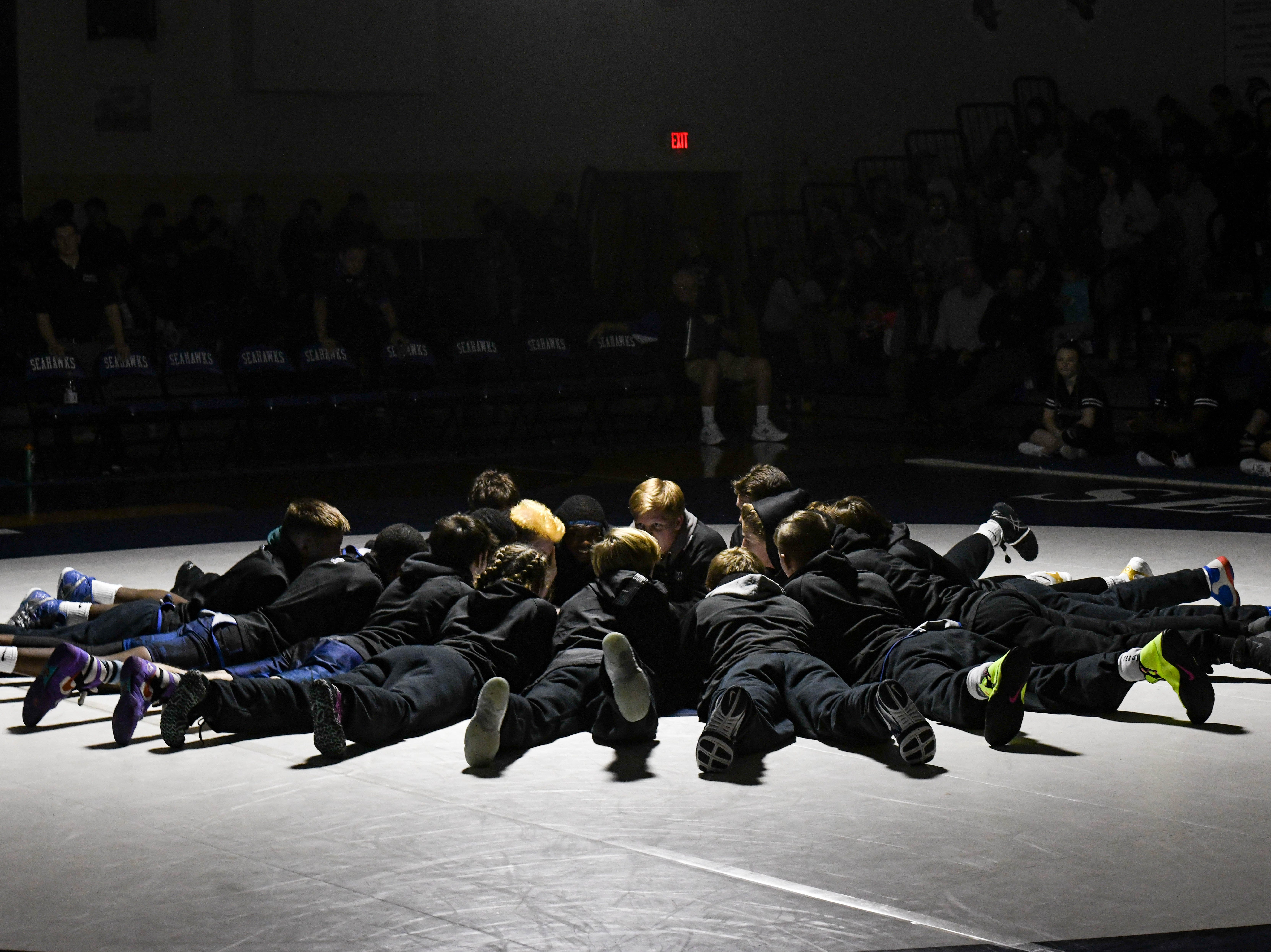 Stephen Decatur wrestlers warm up before a match against  Parkside at Stephen Decatur High School on Wednesday, Jan. 23, 2019.