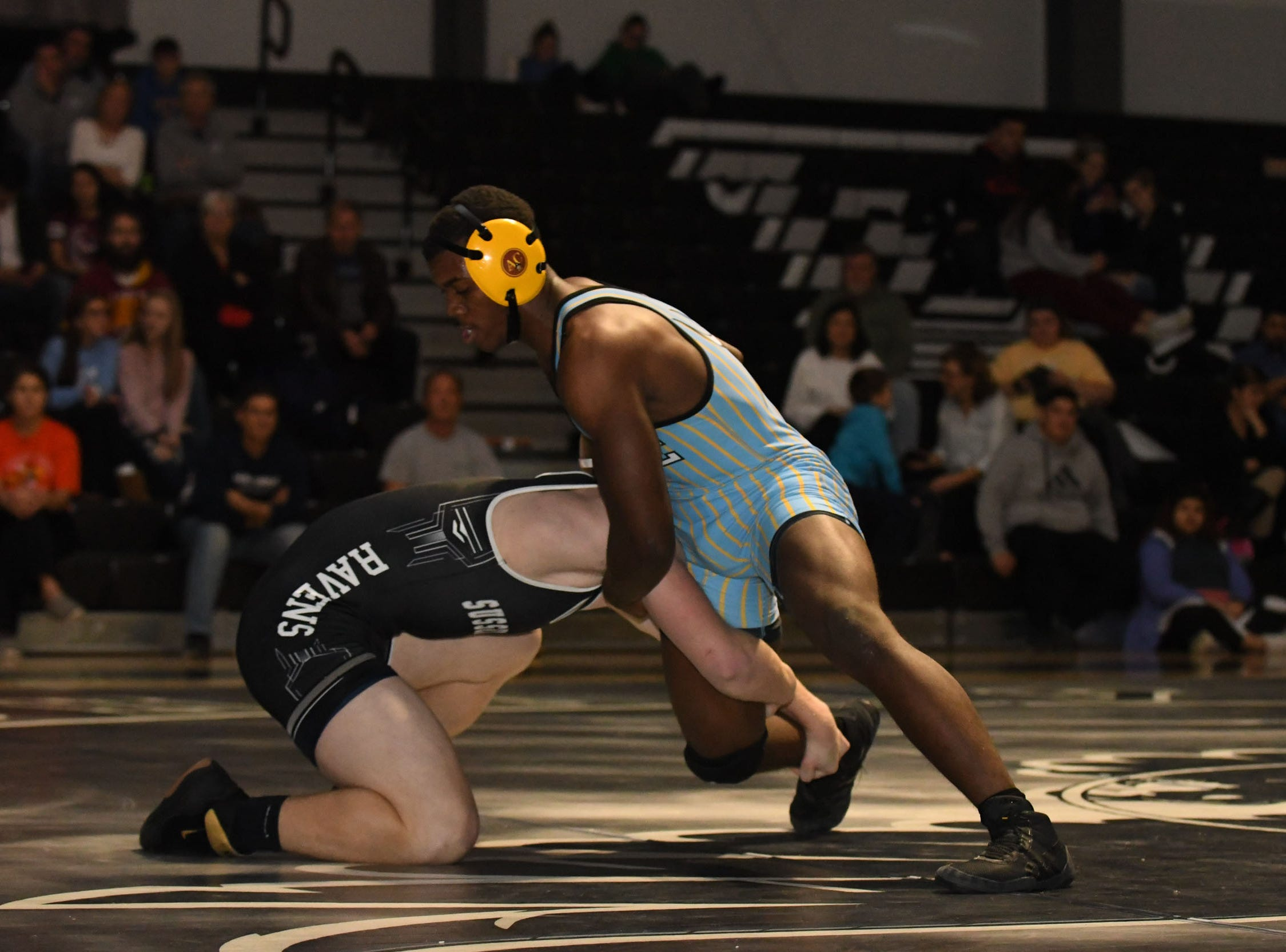 Sussex Tech's Trey Hatfield faced off against Cape Henlopen's Roy Jones during the 170lb match on Wedenesday, Jan. 23, 2019 at Sussex Tech High School in Georgetown, Del.
