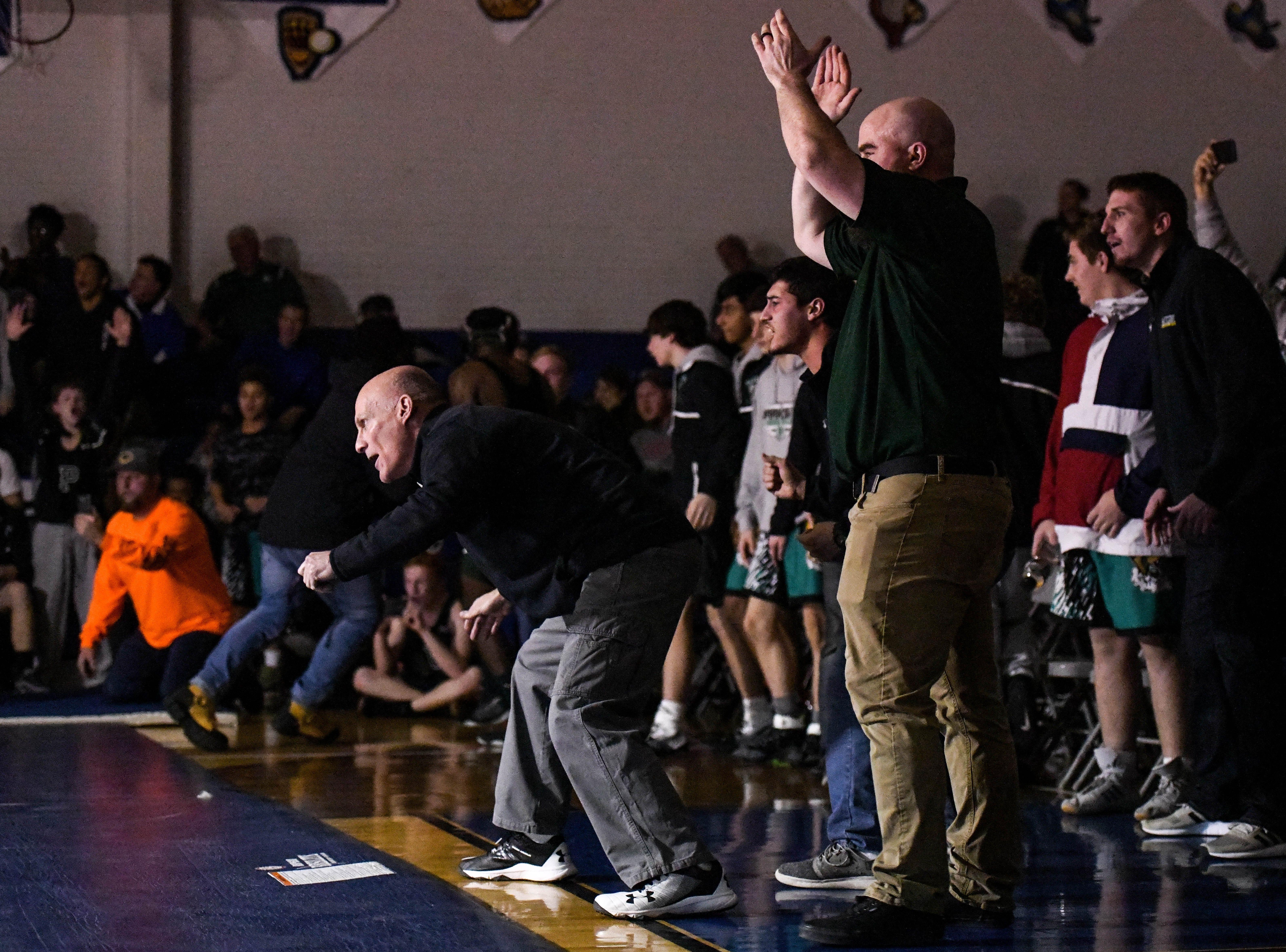 Parkside's Burt Cashman coaches the team at a match at Stephen Decatur High School on Wednesday, Jan. 23, 2019.