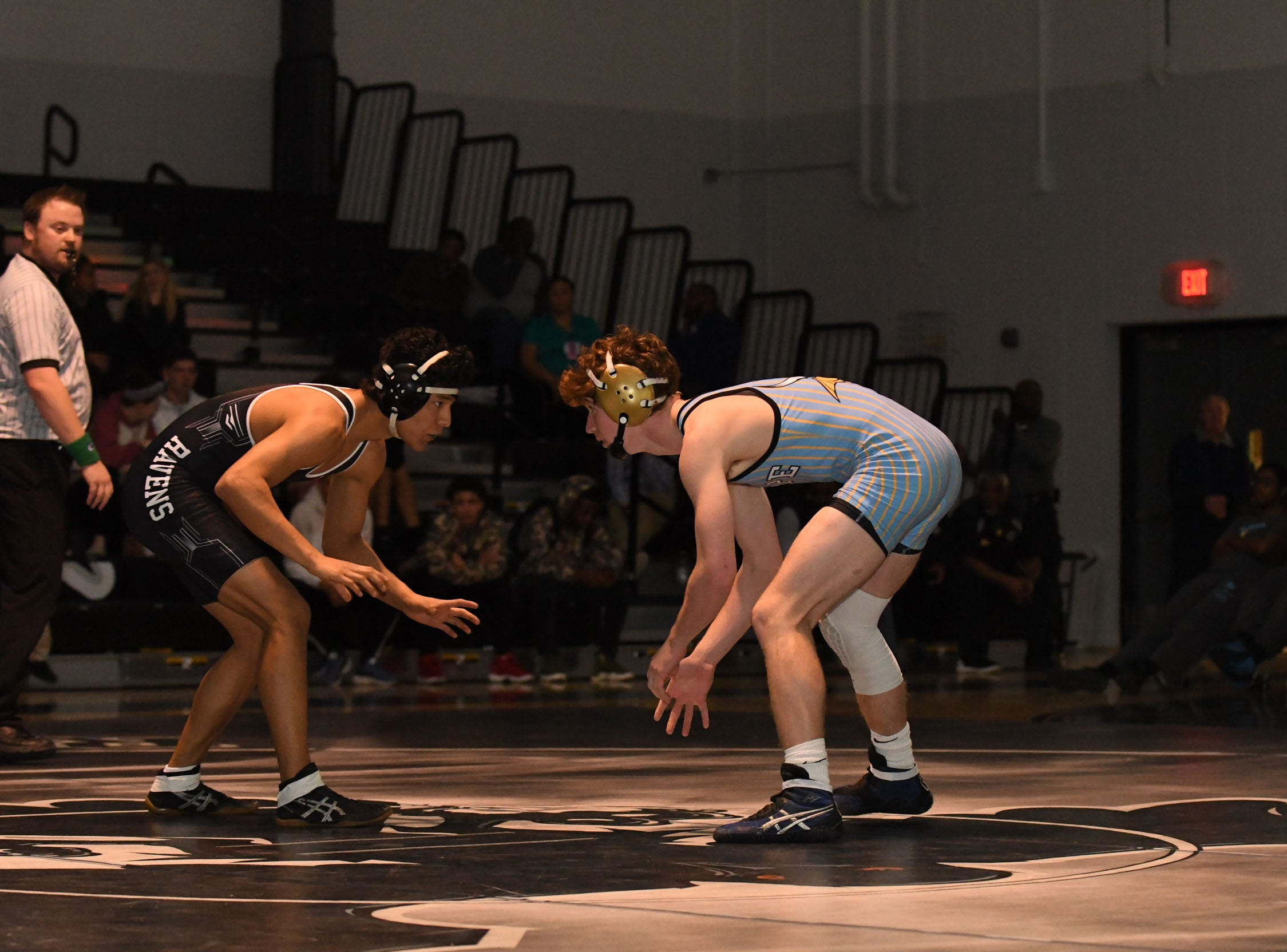 Sussex Tech's Roberto Santos faced off against Cape Henlopen's Finbar Rishko during the 138lb match on Wedenesday, Jan. 23, 2019 at Sussex Tech High School in Georgetown, Del.