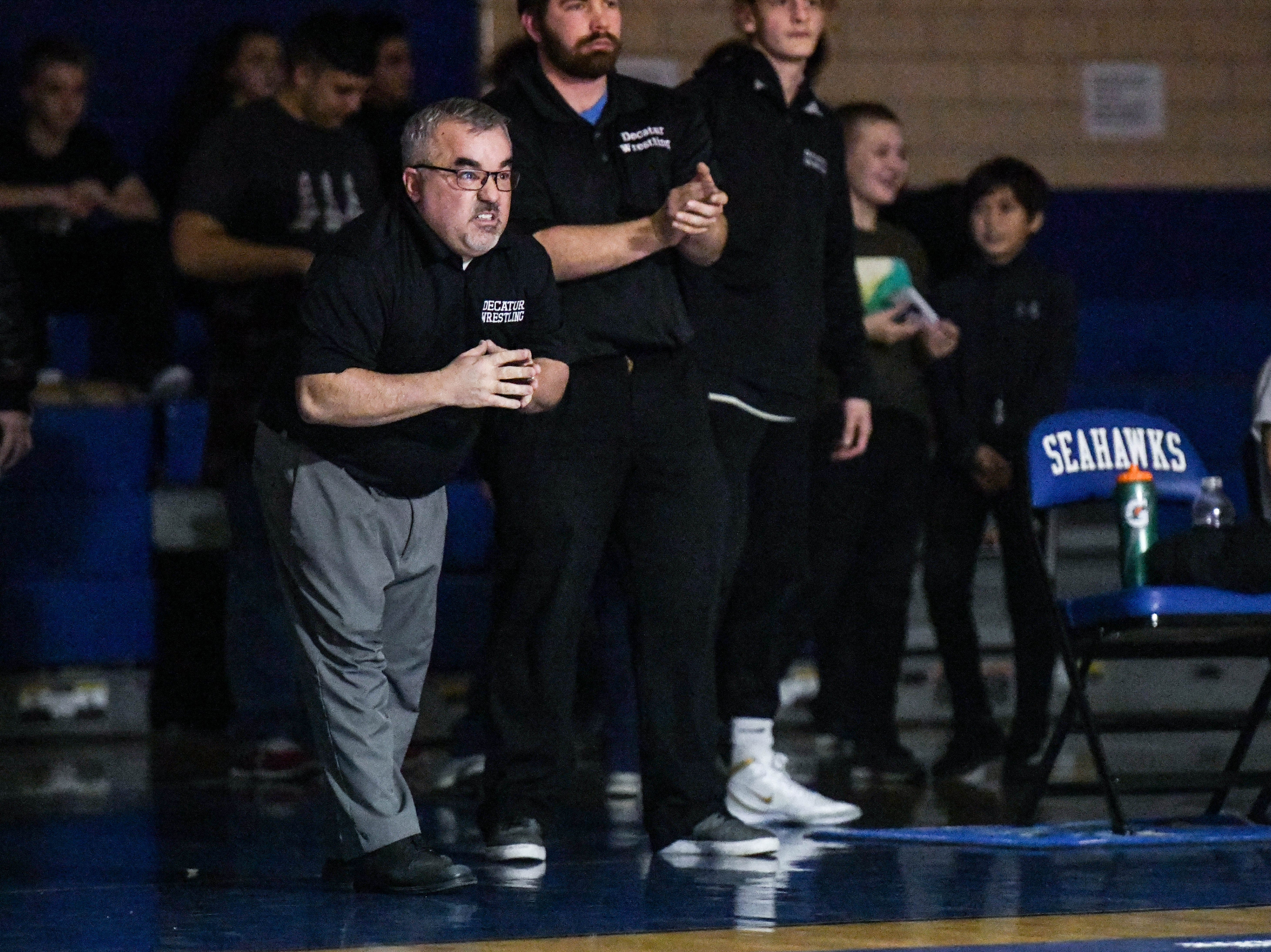 Stephen Decatur's Todd Martinek coaches the team at a match against Parkside at Stephen Decatur High School on Wednesday, Jan. 23, 2019.