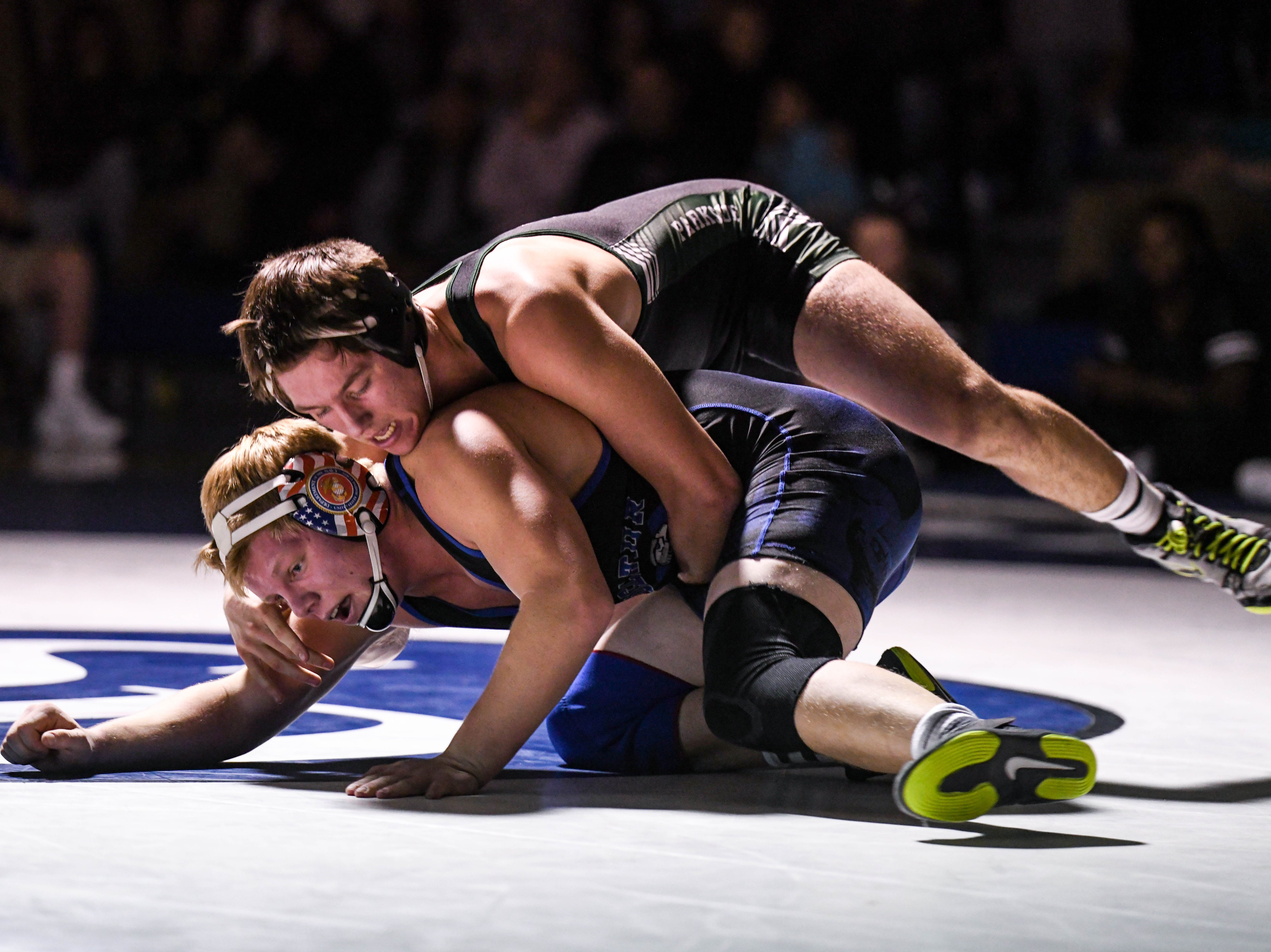 Stephen Decatur's Lukas Layton wrestles against Parkside's Eli Sellinger in the 170 match up at Stephen Decatur High School on Wednesday, Jan. 23, 2019.