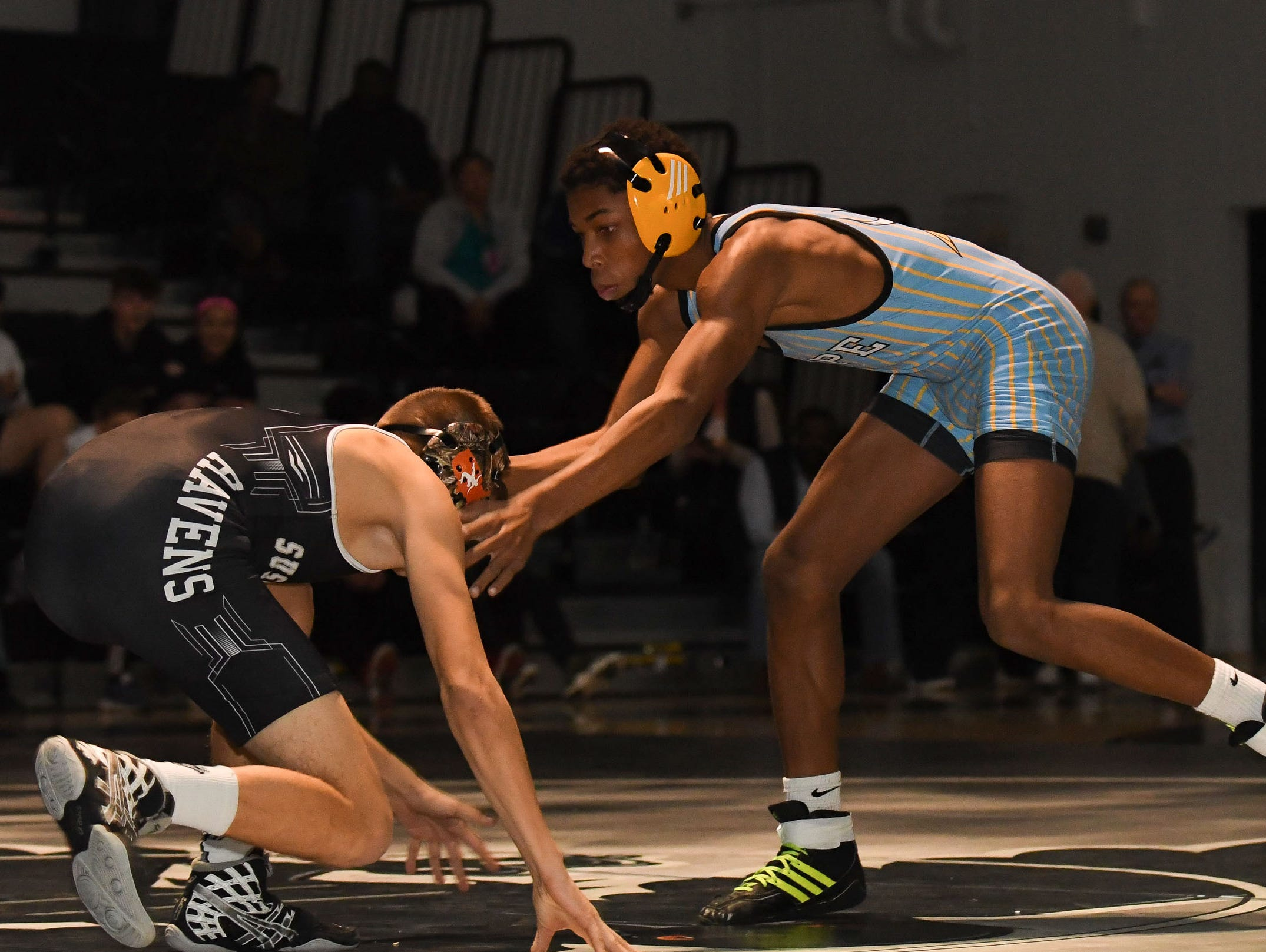 Sussex Tech's Hunter Ruff faced off against Cape Henlopen's Darryl Sykes during the 113lb match on Wedenesday, Jan. 23, 2019 at Sussex Tech High School in Georgetown, Del.
