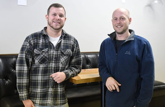 Stephen Masten and David Knestout, Owners of Pit n' Pub stand in their new location located across from Salisbury University.