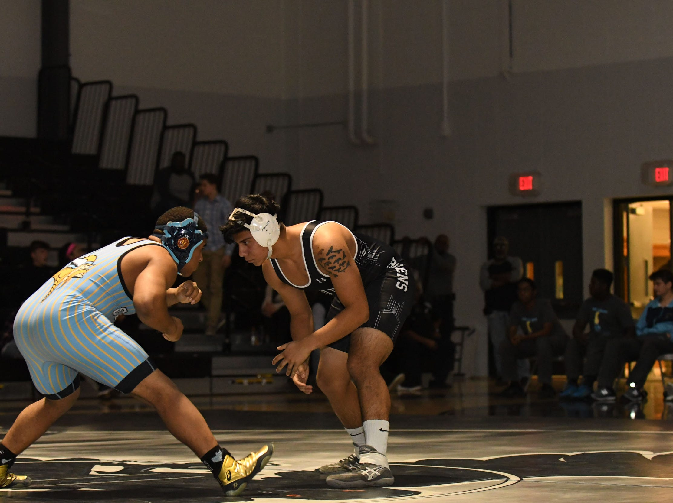Sussex Tech's Daniel Alvarez faced off against Cape Henlopen's Eduardo Saez during the 182lb match on Wedenesday, Jan. 23, 2019 at Sussex Tech High School in Georgetown, Del.