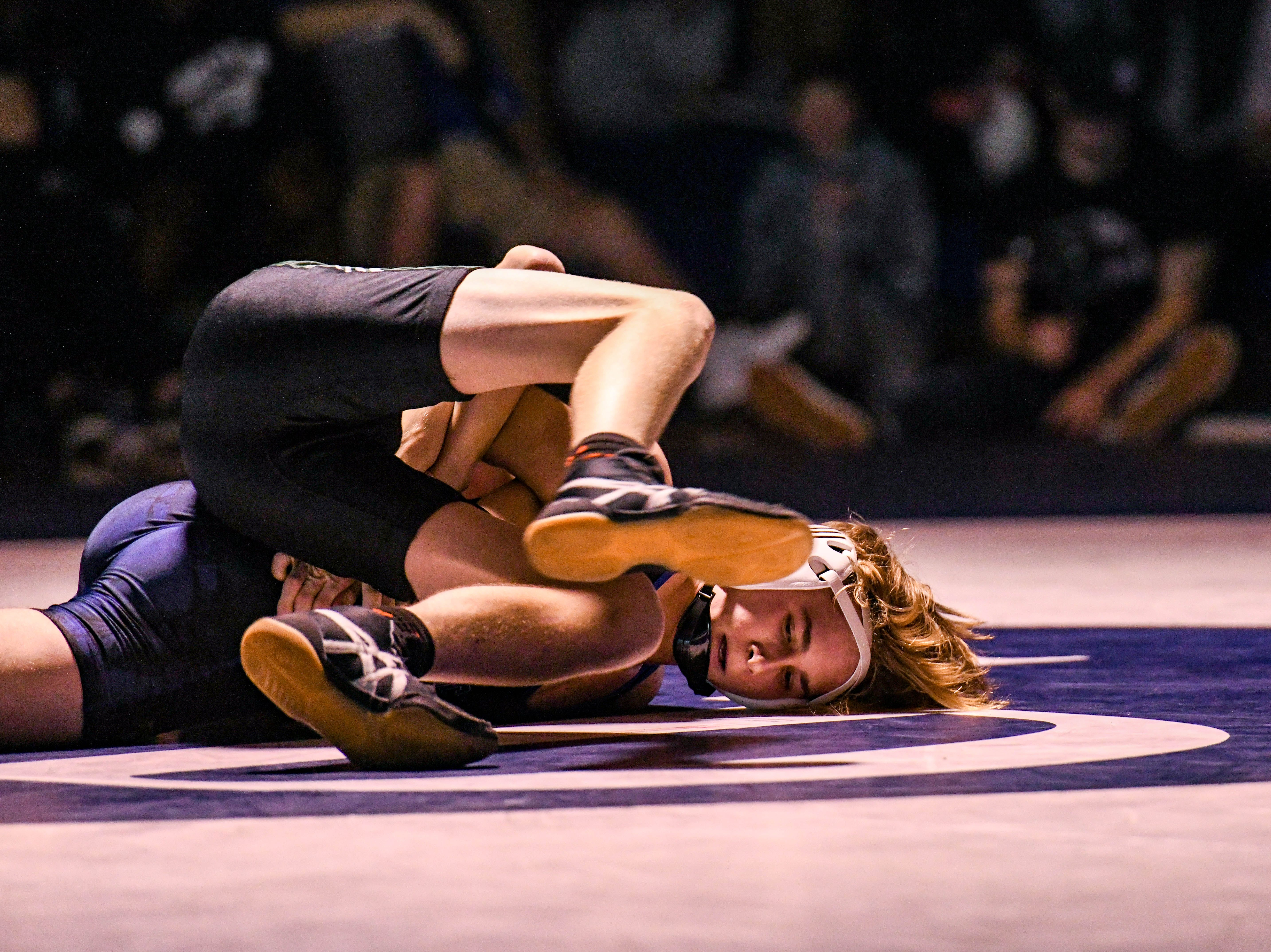 Stephen Decatur's Caleb Myers wrestles against Parkside's Landon Church in the 106 match up at Stephen Decatur High School on Wednesday, Jan. 23, 2019.