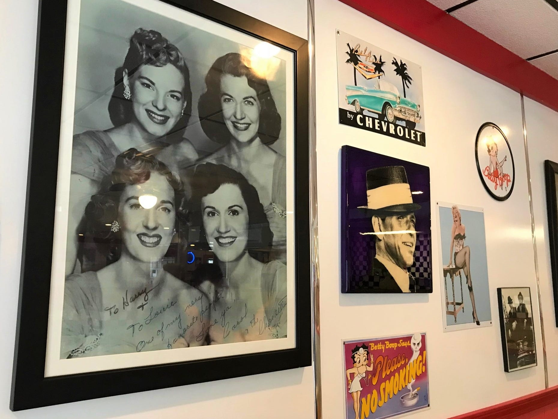 Throughout Harry's Diner are mementos of the 50s like a signed photo of the Chordettes.