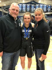 Macy Guebert (middle) with her parents Dan and Melissa