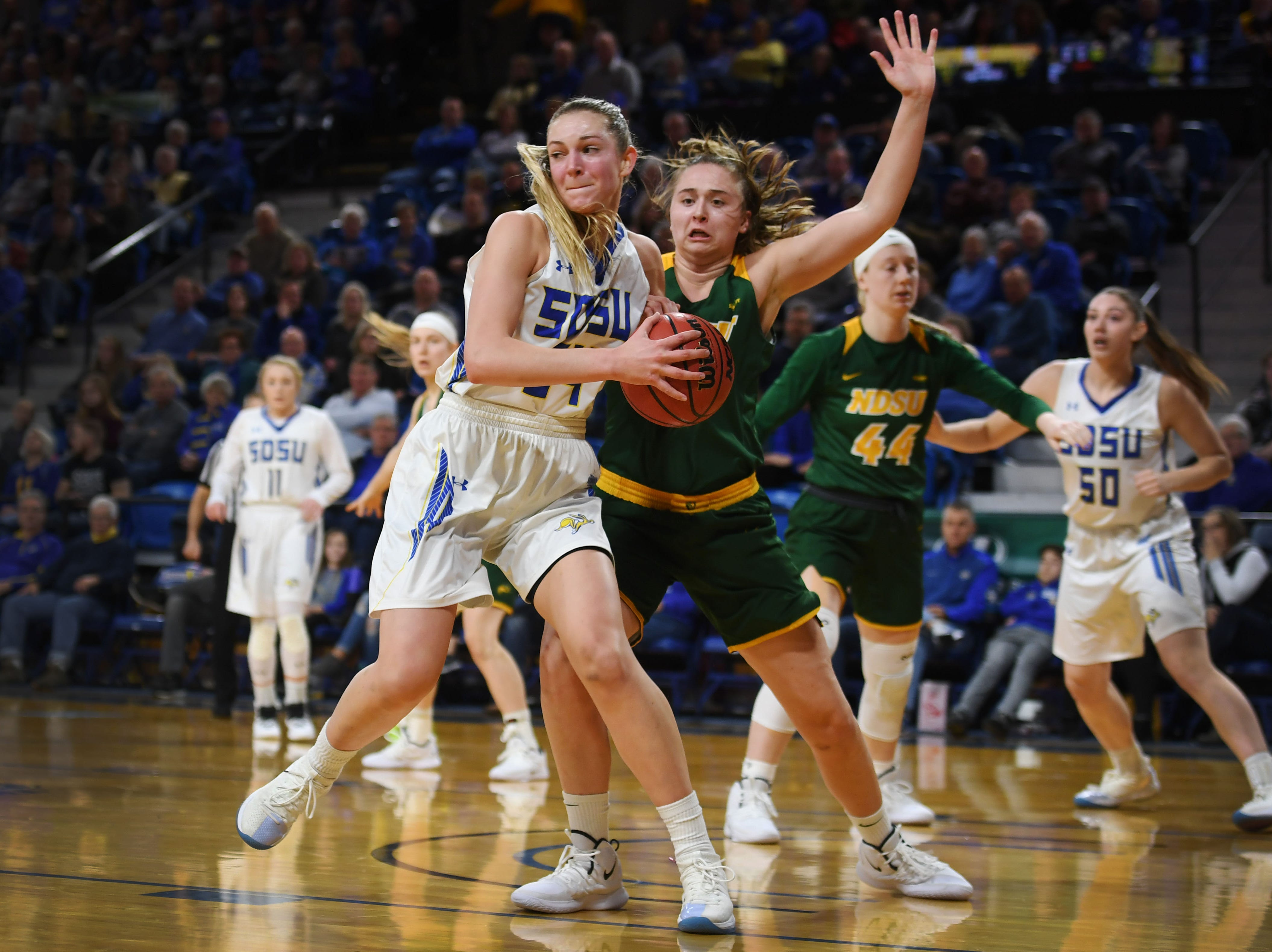 SDSU's Tagyn Larson goes against NDSU defense during the game Wednesday, Jan. 23, at Frost Arena in Brookings.
