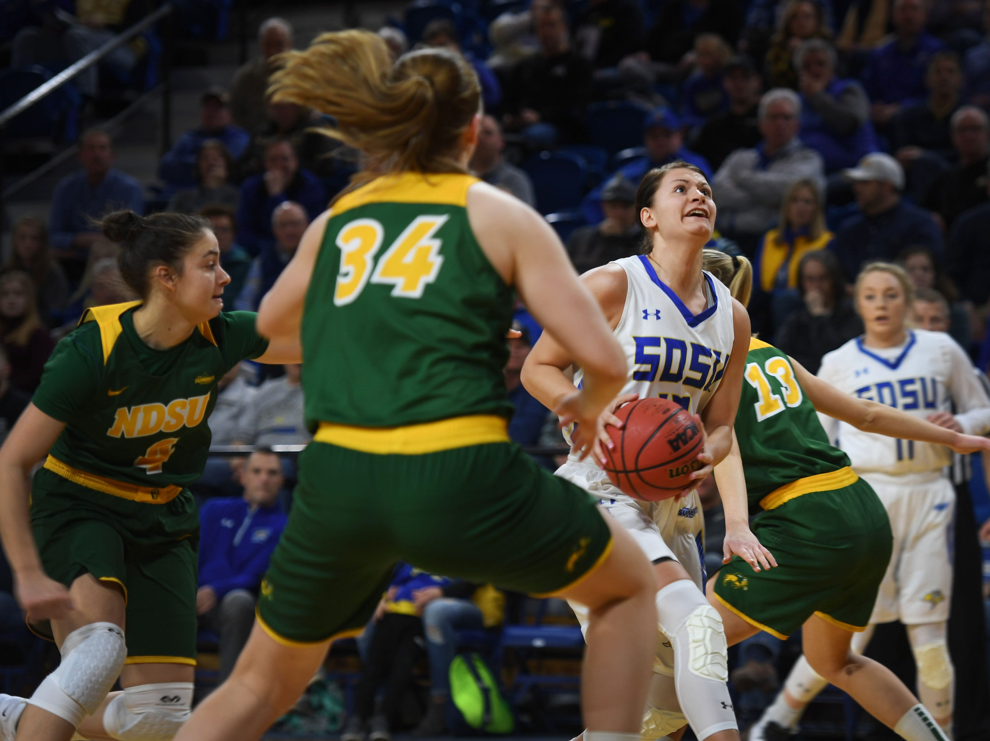 SDSU's Macy Miller goes against NDSU defense during the game Wednesday, Jan. 23, at Frost Arena in Brookings.