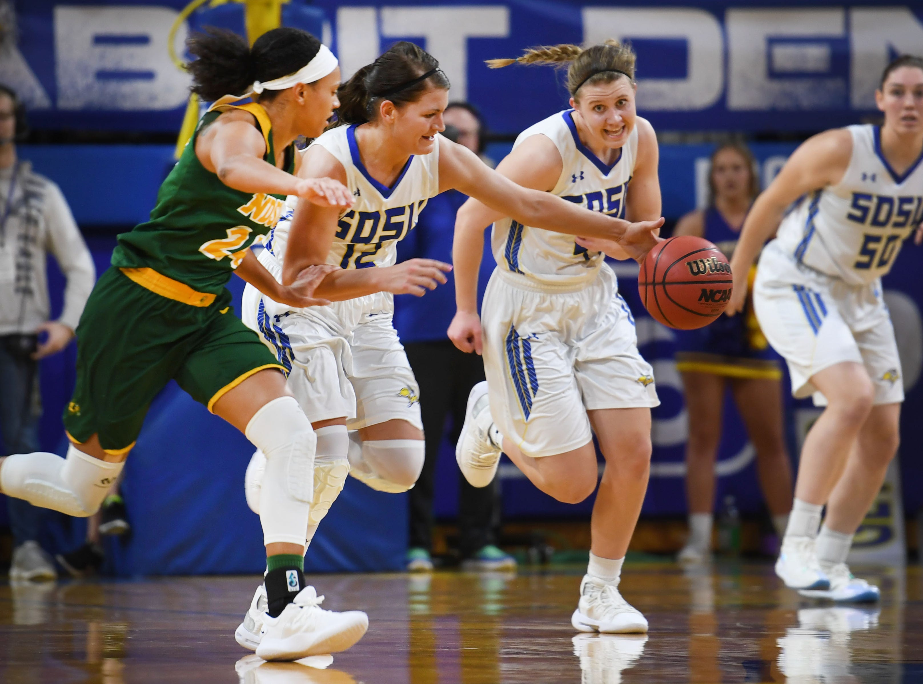 SDSU's Macy Miller runs up the court to gain control of the ball against NDSU's Tyrah Spencer during the game Wednesday, Jan. 23, at Frost Arena in Brookings.