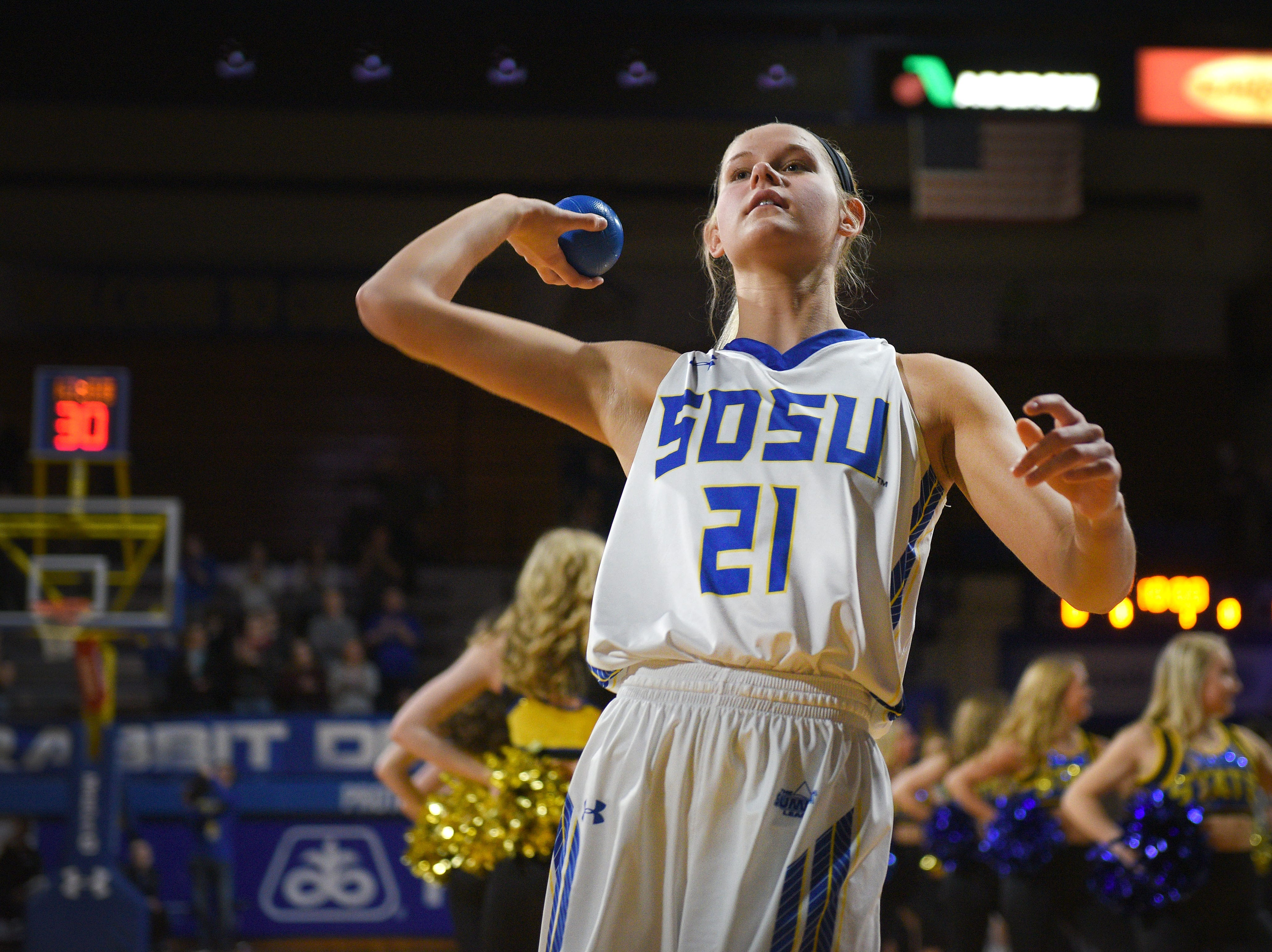 SDSU's Tylee Irwin throws a ball out into the crowd before the game against NDSU Wednesday, Jan. 23, at Frost Arena in Brookings.