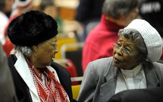 Emma Armstrong (left) and Catherine Teer talk during the Martin Luther King Jr. Day Celebration at the Multi-Cultural Center in 2010.