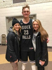 Drew Guebert after a game with his sisters, Madison and Macy