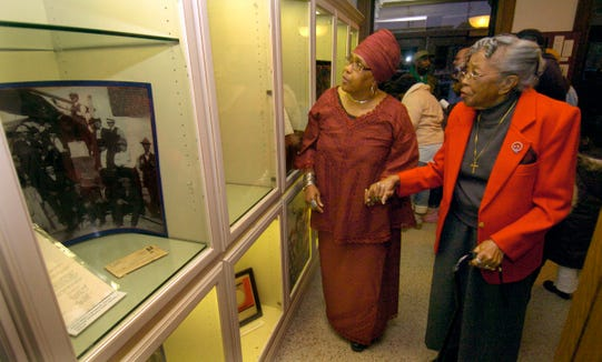 In this 2009 photo, 92-year-old Emma Armstrong (right) reads the displays at the South Dakota African American History Museum.