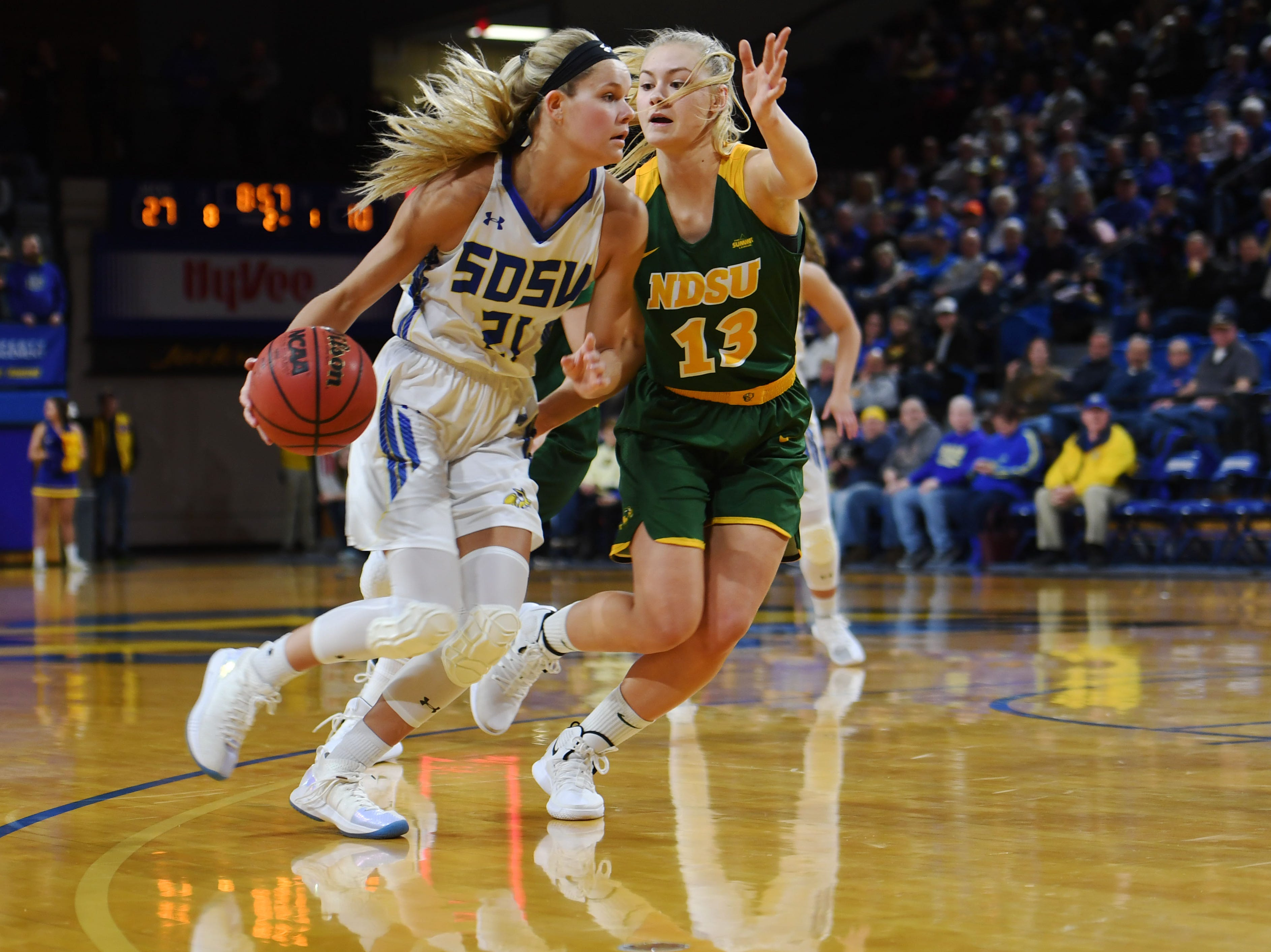 SDSU's Tylee Irwin goes against NDSU's Cirkeline Rimdal during the game Wednesday, Jan. 23, at Frost Arena in Brookings.
