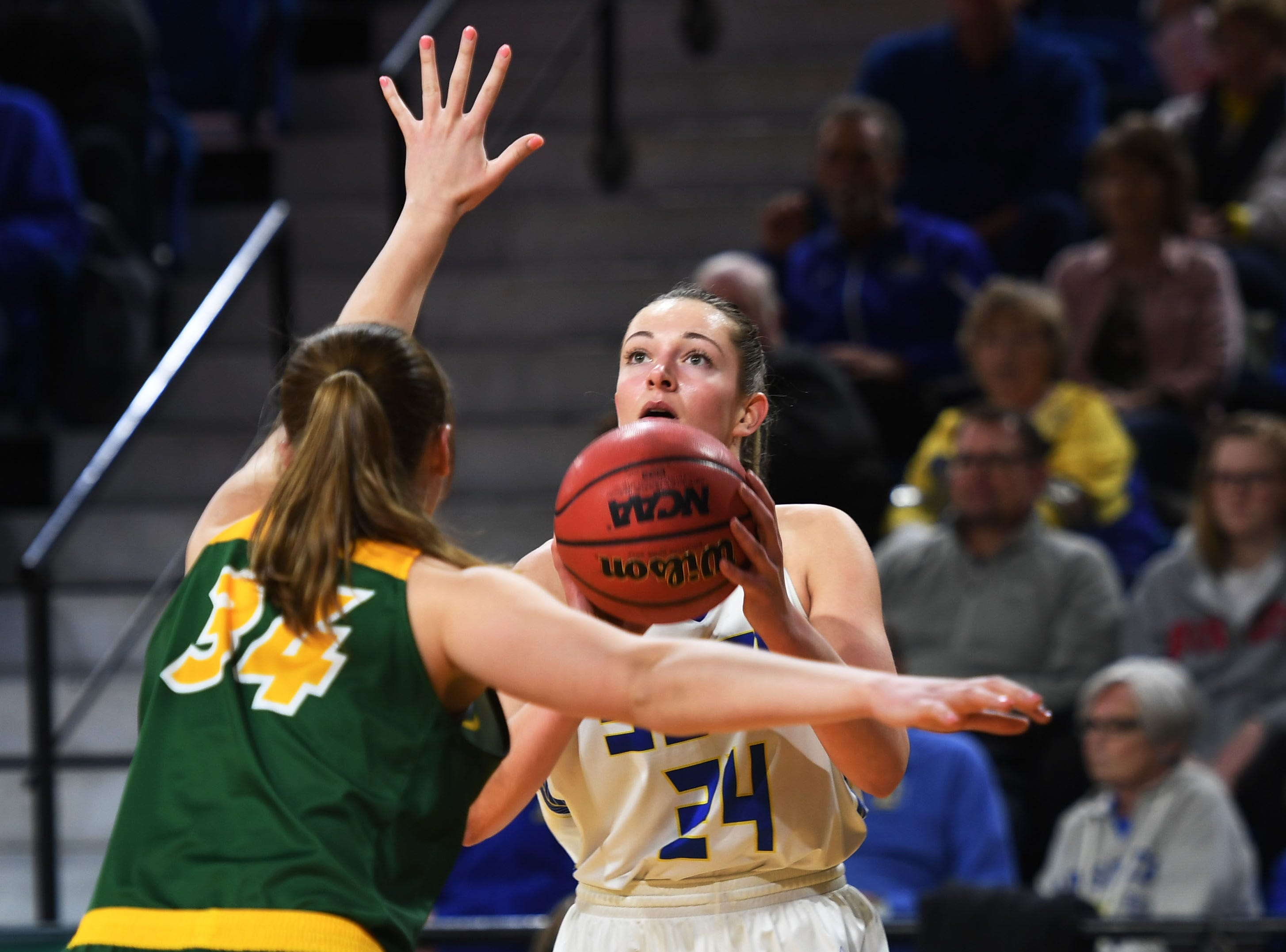 SDSU's Tagyn Larson attempts to shoot against NDSU Wednesday, Jan. 23, at Frost Arena in Brookings.