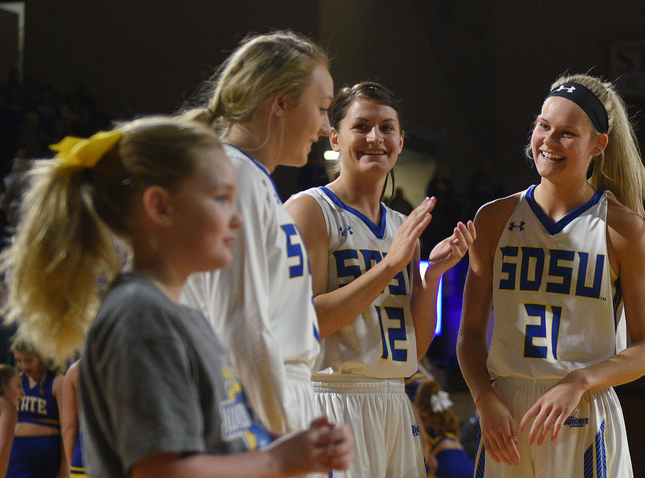 SDSU's Tylee Irwin, far right, joins her teammates on the court before the game against NDSU Wednesday, Jan. 23, at Frost Arena in Brookings.