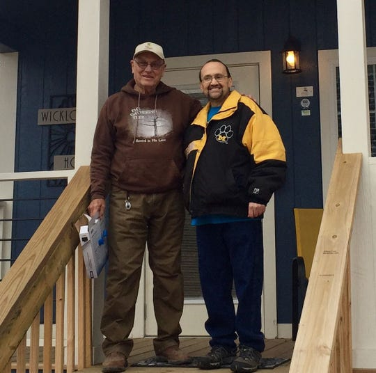 Eden Village co-founder Dr. David Brown and Joey Moreira in December of 2018, the day Moreira was given a key to his new home. Moreira died a few weeks later.