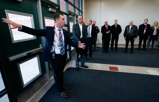Nixa High School Principal Mark McGehee shows administrators and school board members the proposed location for a new performing arts center at the school during a tour in late January.