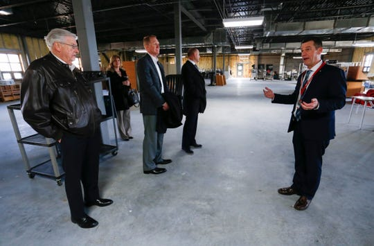 Nixa High School Principal Mark McGehee shows administrators and school board members an unfinished area of the school on Thursday, Jan. 24, 2019.