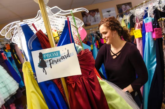 Manager Lisa McCalla looks through dresses available as part of the Prom it Forward Program Wednesday, Jan. 23, at Rapids Alterations & Repair in Sauk Rapids. Proceeds from an upcoming Prom it Forward sale event will fund services provided by the Central Minnesota Sexual Assault Center.