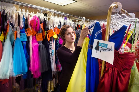 Manager Lisa McCalla looks through a collection of dresses available as part of the Prom it Forward Program Wednesday, Jan. 23, at Rapids Alterations & Repair in Sauk Rapids.