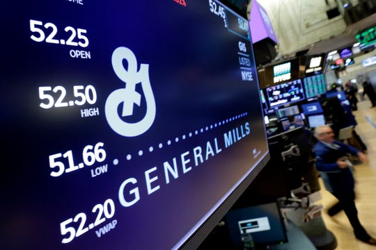 In this Feb. 2018 file photo, the logo for General Mills appears above a trading post on the floor of the New York Stock Exchange.