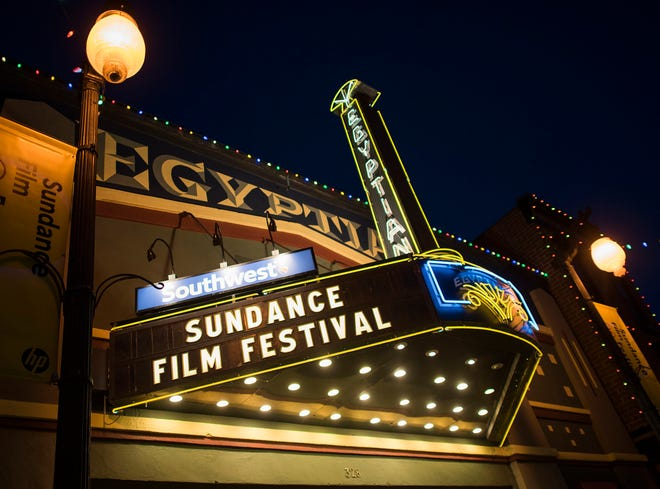 FILE - In this Thursday, Jan. 22, 2015, file photo, the Egyptian Theatre is lit up on Main Street during the first night of the Sundance Film Festival in Park City, Utah. The mountainside festival, which kicks off Thursday, Jan. 24, 2019, in Park City, Utah, has become known for launching nonfiction films to box office successes and awards, and this year is shaping up to be no different. (Photo by Arthur Mola/Invision/AP, File)