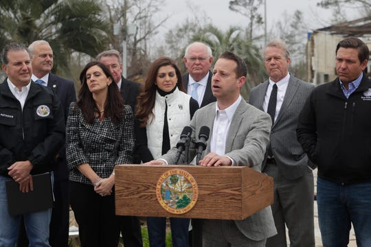 Florida Emergency Management Director Jared Moskowitz speaks at a press conference held in front of a Hurricane Michael damaged building in Marianna where Gov. Ron DeSantis announced that the deadline for getting 100 percent reimbursement of hurricane recovery costs has been changed from five to 45 days.