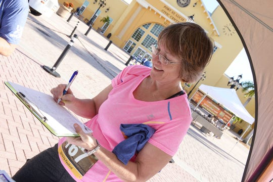 Donna Teixeira signs up for the Billion Step Challenge at the Treasure Coast Fit Festival at the Port St. Lucie Civic Center.