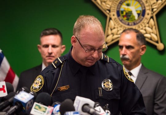 Sebring Police Department Chief Karl Hoglund leaves the podium after speaking at a news conference Thursday, Jan. 24, 2019, about the five people killed Wednesday at a SunTrust Bank branch in Sebring, Fla.