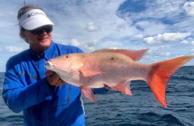 """George Poveromo of television's """"George Poveromo's World of Saltwater Fishing,"""" now in its 19th season, hoists a mutton snapper caught recently in the Keys."""