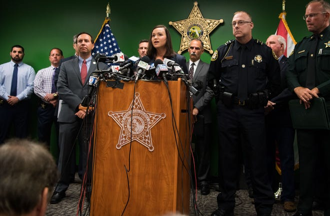 Florida's Attorney General Ashley Moody (center) speaks at the Highlands County Sheriff's Office during a news conference Thursday, Jan. 24, 2019, about the five people killed Wednesday at a SunTrust Bank branch in Sebring, Fla.
