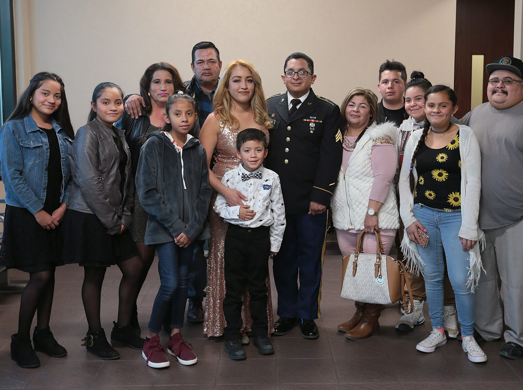 Judge Patrick Garcia marries Randy Juarez and Carla Perez as the jury deliberates in a murder trial in the 384th District Court Tuesday. Juarez is a mechanic with the New Mexico National Guard's 919th Military Police. Their families were present to witness the ceremony which took place in the judge's chambers.