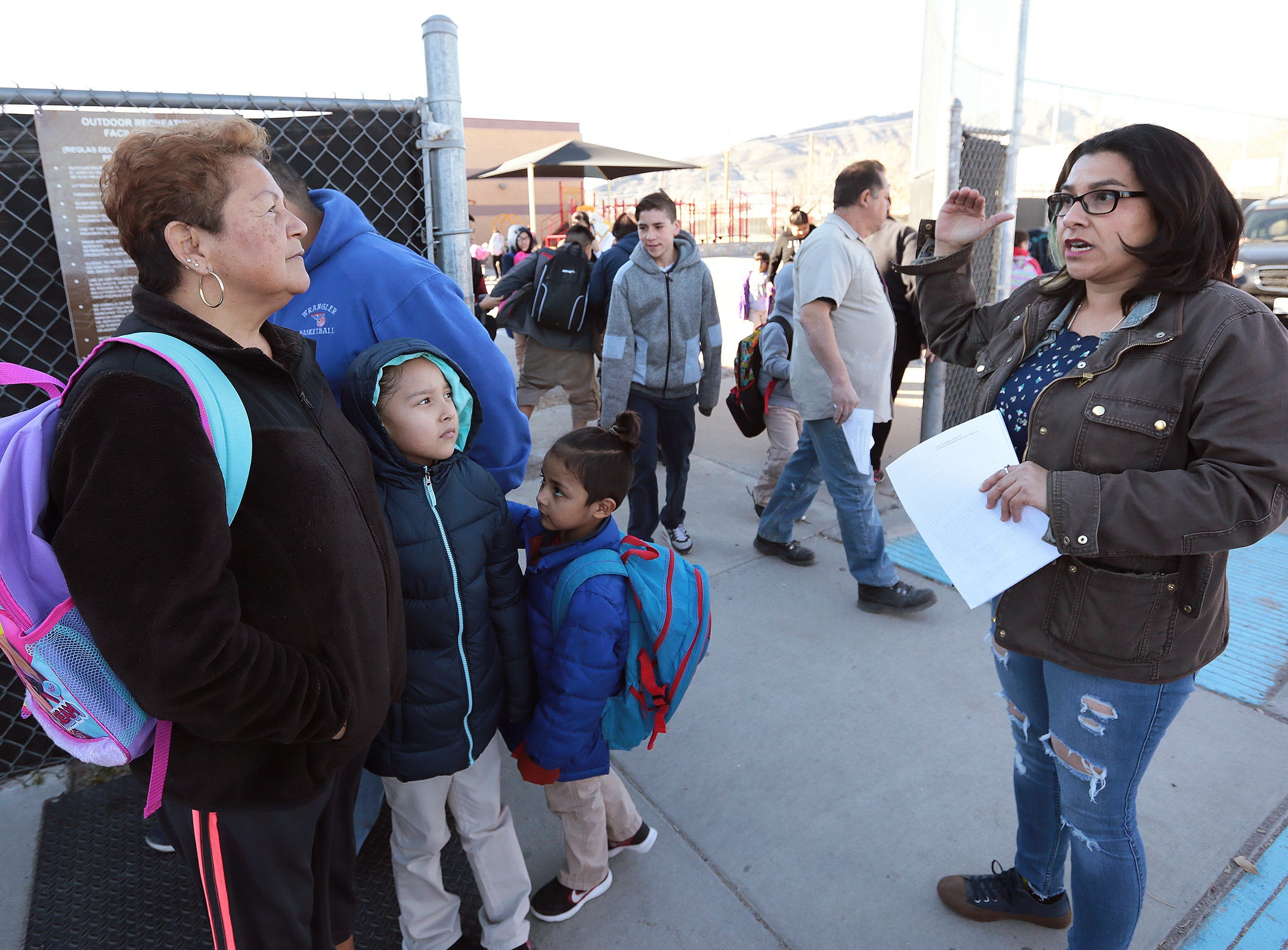 Hilda Villegas, a Beall Elementary School mother and member of Familias Unidas del Chamizal rallies parents during release Wednesday to fight to keep their school open. The EPISD Board voted Tuesday to close the school and three others.