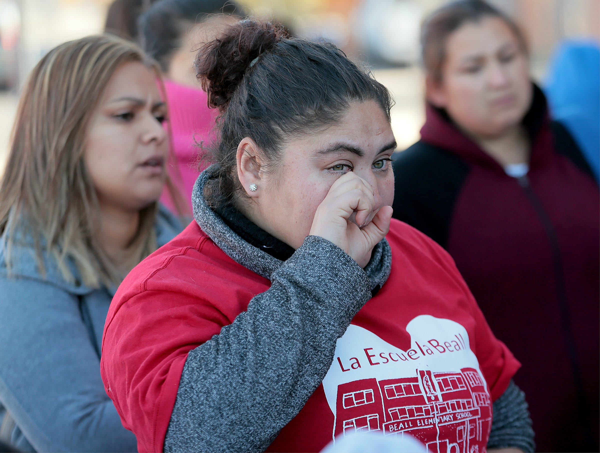 Parents of Beall Elementary School students rally Wednesday to keep their school open. The EPISD Board voted Tuesday to close the school and three others.