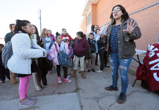 Hilda Villegas, a Beall Elementary School mother and member of Familias Unidas del Chamizal rallies parents during release Wednesday, Jan. 23, to fight to keep their school open. The EPISD Board voted Tuesday, Jan. 22, to close the school and three others.