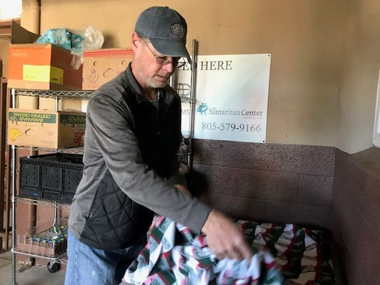 Ron Goode, a homeless resident of Simi Valley who relies on food stamps, prepares a table for a dinner served at the Samaritan Center.  The center in Simi Valley offers a drop-in center for the homeless and a community food pantry.