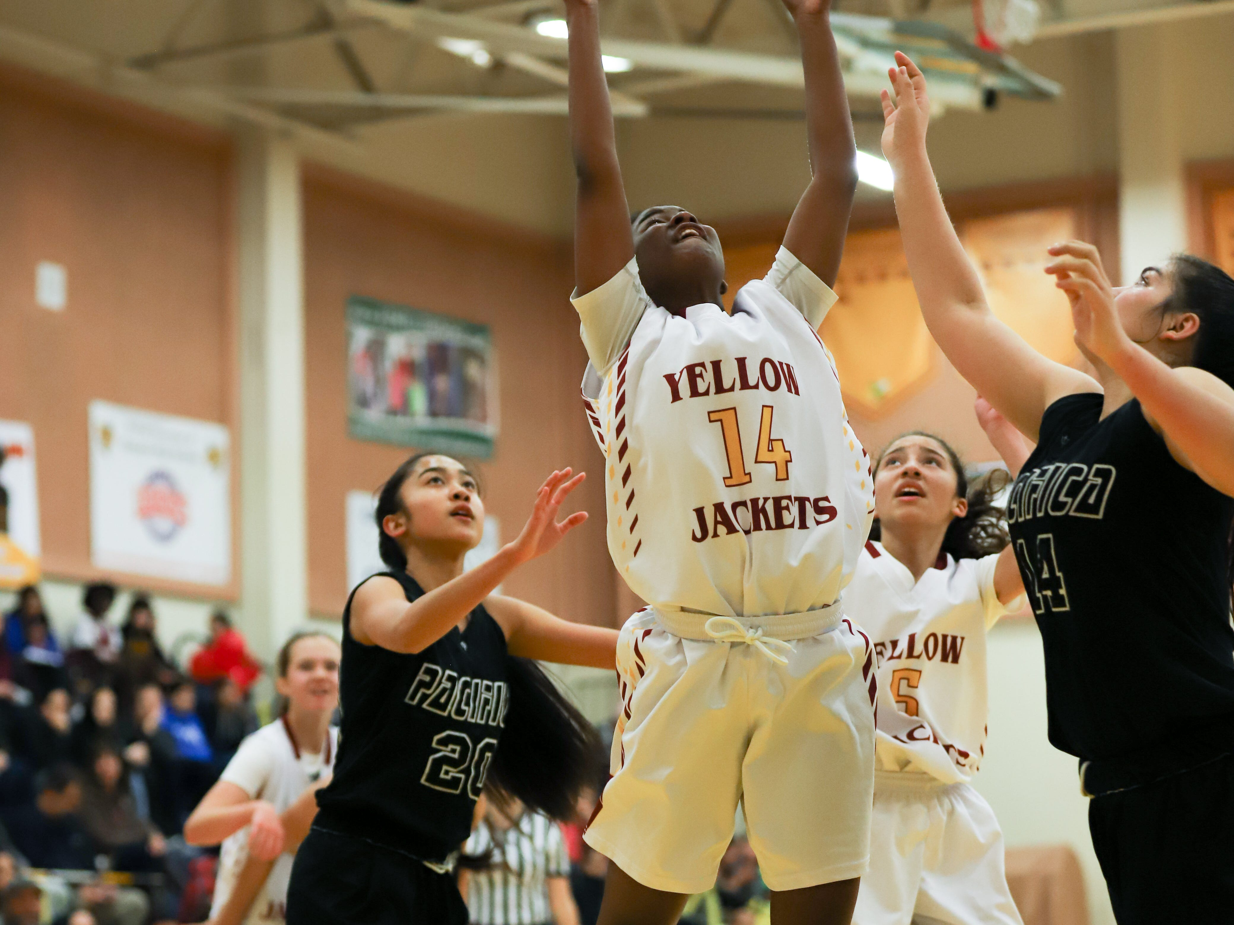 Monae Baxter goes to the basket during a recent Oxnard High game.