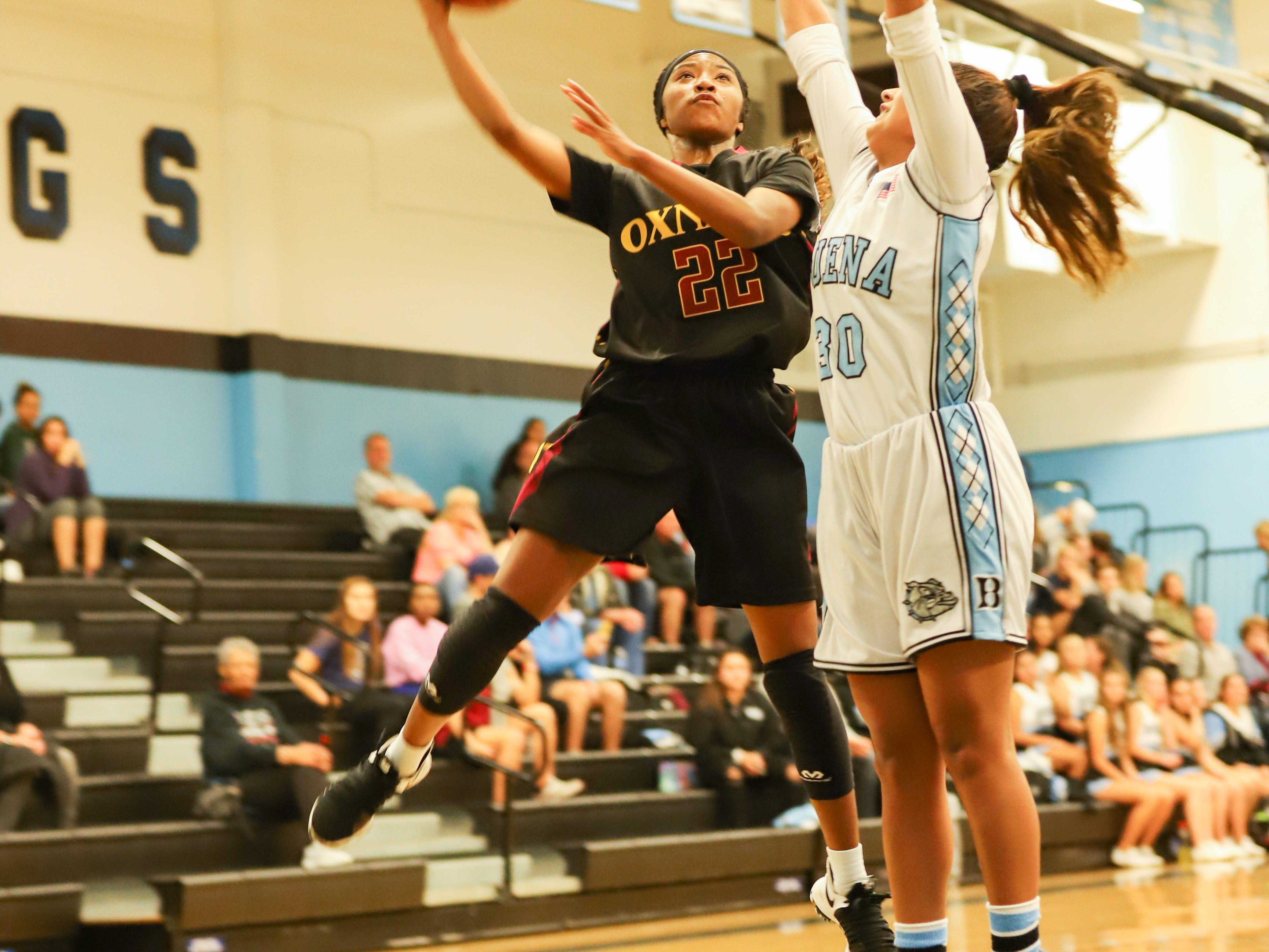 Myesha Lumas, left, is the leading scorer of a well-balanced Oxnard High girls basketball team.